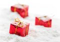 Gifts on snow red gift boxes with white shot Stock Images