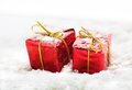 Gifts on snow red gift boxes with white shot Royalty Free Stock Photo