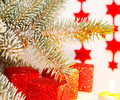 Gifts under christmas tree and stars Stock Images