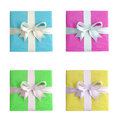 Gifts with white ribbon on a white background Royalty Free Stock Photo