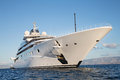 Gigantic big and large luxury mega or super motor yacht on the o blue ocean Stock Photo