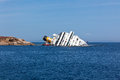 GIGLIO, ITALY - APRIL 28, 2012: Costa Concordia Cruise Ship at I Royalty Free Stock Photo