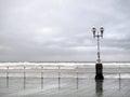Gijon promenade with lamppost in rainy day