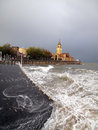 Gijon promenade with rough sea under storm Stock Images