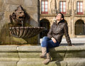 Gijon woman tourist sitting relaxing plaza marques gijon spain happy woman vacations europe fountain monument to don pelayo Royalty Free Stock Image