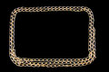 Gilded chainlet on a black background Royalty Free Stock Photo