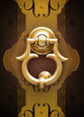 Gilded knocker on decorated background Royalty Free Stock Photography