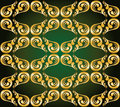 Gilded ornament on green Stock Image