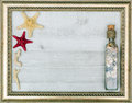 Gilded picture frame with starfish inside Royalty Free Stock Photo