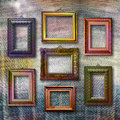 Gilded wooden frames for pictures on jeans background blue Royalty Free Stock Image