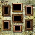 Gilded wooden frames for pictures on old rusty wall metallic Royalty Free Stock Image