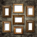 Gilded wooden frames for pictures on stone wall old Royalty Free Stock Images