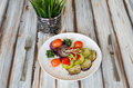 Gilled vegetables salad on wooden table served a plate tomatoes zucchini onion eggplant Royalty Free Stock Photography