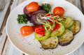 Gilled vegetables salad on wooden table served a plate tomatoes zucchini onion eggplant Stock Photos