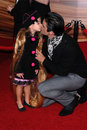 Gilles marini and daughter at the tangled world premiere el capitan theatre hollywood ca Stock Photos