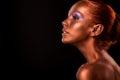 Gilt. Golden Woman's Face Closeup. Futuristic Gilded Make-up. Painted Skin bronze.