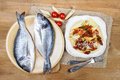 Gilt head bream fish and penne with dried tomatoes on wooden background mediterranean tavern delicious meal Stock Photo