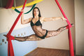 Gimnast on the canvases attractive young caucasian brunette gymnast in lace underwear at height of ceiling Royalty Free Stock Photo