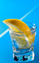 Gin with lemon on a glass table alcohol drink Royalty Free Stock Images
