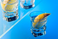 Gin with lemon on a glass table alcohol drink Stock Photography