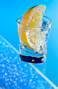 Gin with lemon on a glass table alcohol drink Stock Image