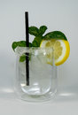 Gin tonic garnished with lemon and a straw Stock Images