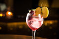 Gin tonic with mix of fruits cocktail night club Stock Image