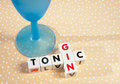 Gin and tonic text inscribed on small white cubes arranged jigsaw style next to a blue glass bright spotted background Royalty Free Stock Photography