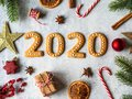 Ginger biscuits of the form of a numbers and 2020 new year ginger cookies on grey background. Top view. Seasonal packaging and New Royalty Free Stock Photo
