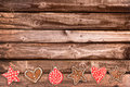 Ginger bread cookies and Christmas ornaments on wooden planks