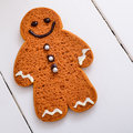 Ginger bread man decorated with chocolate icing and silver buttons Royalty Free Stock Photos
