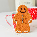 Ginger bread man home made gingerbread with a happy smiley chocolate icing face Royalty Free Stock Images