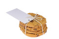 Ginger cookies fresh baked wrapped in string with a blank gift card attached isolated on white Royalty Free Stock Photos
