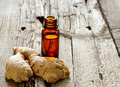 Ginger essential oil in dark glass bottle Royalty Free Stock Images