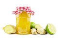 Ginger lime jelly glass jar with fresh homemade with roots and limes Royalty Free Stock Photo