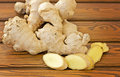 Ginger root and chopped ginger on a wooden table Royalty Free Stock Photography