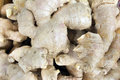 Ginger root closeup background for sale in southeast market Royalty Free Stock Photos