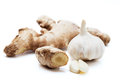 Ginger root with garlic two peeled cloves and a head of on a white background Stock Photos