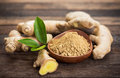 Ginger root and ginger powder Royalty Free Stock Photo