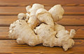 Ginger root on a wooden table Stock Image