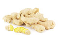 Ginger roots with slices on white Stock Photos