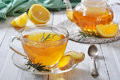 Ginger tea with lemon and rosematy in glass cup closeup Stock Photos