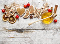 Gingerbread christmas cookies and bowl of honey on wooden table top view copy space Stock Photos