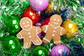 Gingerbread Christmas Men with bunch of Colorful baubles and tin