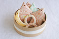 Gingerbread christmas toys in round box houses tree moon beige Stock Photography