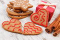 Gingerbread with cinnamon and gifts for christmas on old wooden background christmas time fresh baked homemade decorated cookies Stock Photos