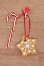 Gingerbread cookie christmas snowflake hanging on a line with rock cane candy bar Royalty Free Stock Image