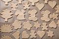 Gingerbread cookie in different shapes on light baking paper lik
