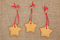 Gingerbread cookies christmas hanging on a line with red heart pegs over hessian background Royalty Free Stock Photography