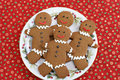Gingerbread cookies on a Christmas plate. Royalty Free Stock Photo